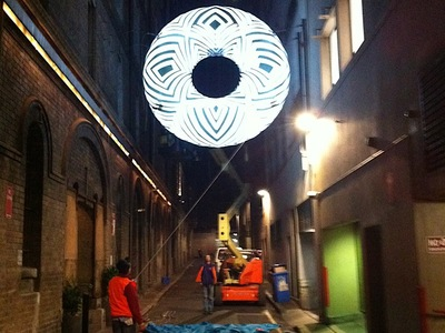 Brook Andrew's Inflatable Donut in Sydney Alley